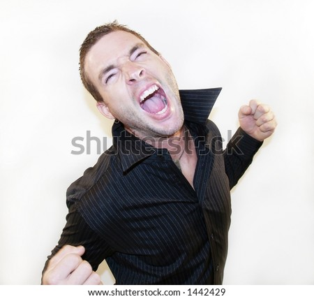 man screaming with fist in air - stock photo