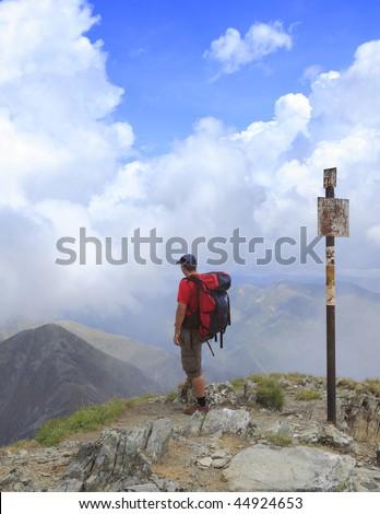 Man scrutinizing the horizon in mountains. - stock photo