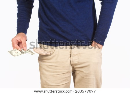 Man Searching for Cash in his Pockets - stock photo