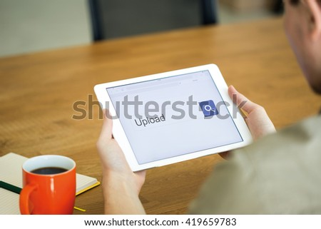 Man searching UPLOAD with tablet pc - stock photo