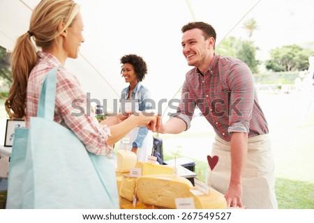 Man Selling Fresh Cheese At Farmers Food Market - stock photo