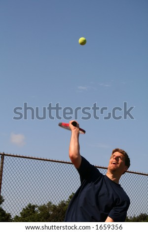 Man Serving Tennis Ball - 4 - stock photo