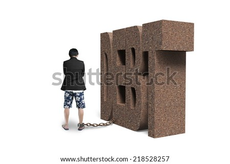 man shackled by DEBT isolated on white - stock photo