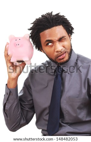 Man shaking a piggy bank - stock photo
