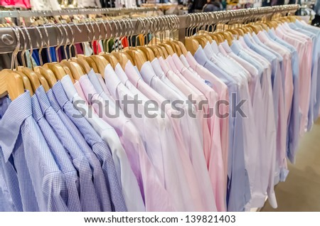 Man Shirts On Hanger - stock photo
