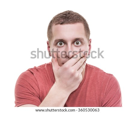 Man shocked covers her mouth isolate on a white background. - stock photo