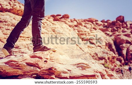 Man shoes canvas outdoor travel hiking red rock mountain on summer vintage style  - stock photo