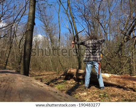 man shoot with a recurve bow in the forest - stock photo