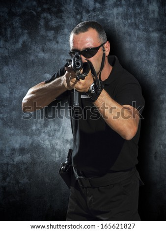 Man shooting with the big guns - stock photo