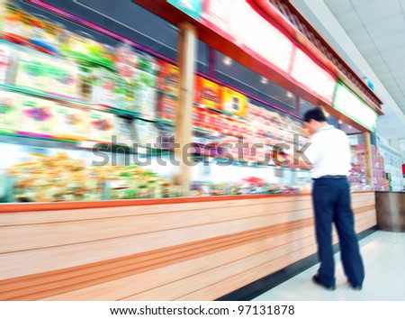 Man shopping in the supermarket - stock photo