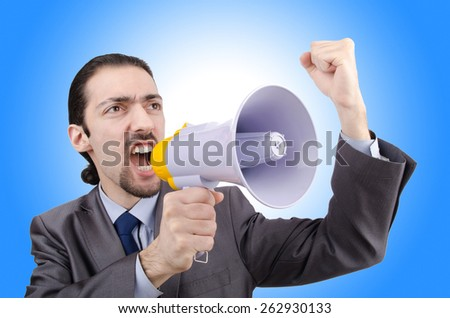 Man shouting and yelling with loudspeaker - stock photo
