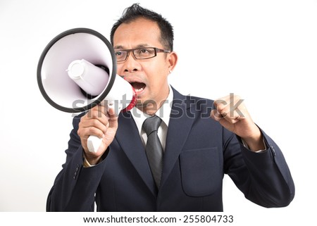 Man shouting and yelling with loudspeaker. Isolated white background - stock photo