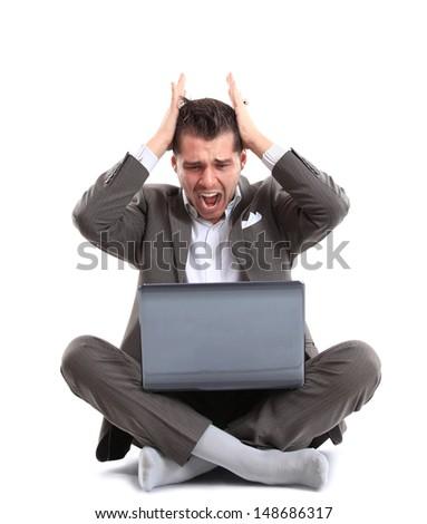 Man shouting at laptop  - stock photo