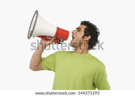 Man shouting into a megaphone - stock photo