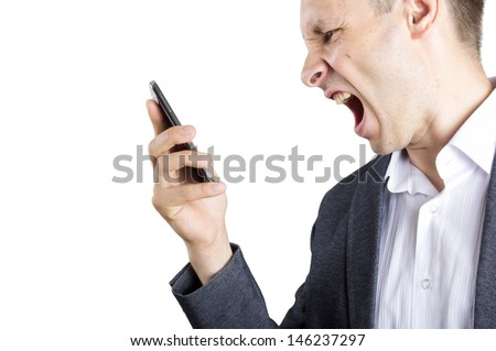 man shouting to the cellphone - stock photo
