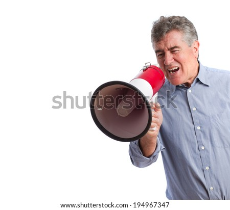 Man shouting with a megaphone - stock photo