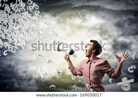 man shouts through a megaphone. from the megaphone off abstract symbols - stock photo