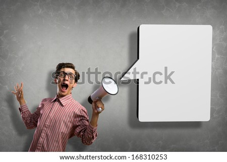 man shouts through a megaphone. from the megaphone off chat box - stock photo