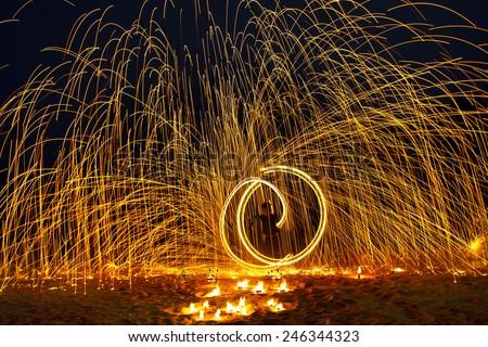 Man show swing fire - stock photo