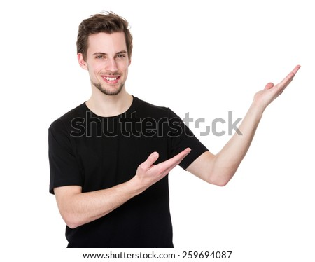 Man showing blank copy space on the palm - stock photo