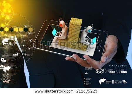Man showing 3d people working in laptop - stock photo