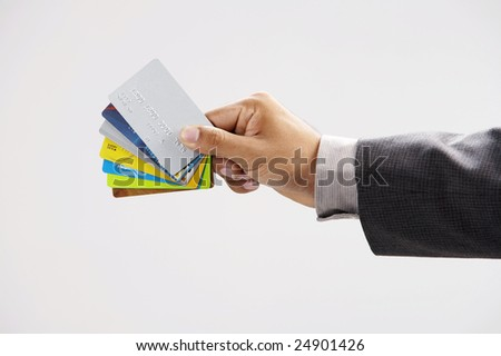 man showing few credit cards with white background - stock photo