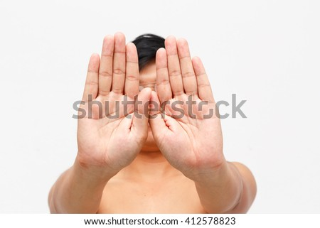 Man showing gesturing stop with hand - stock photo