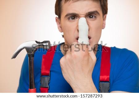 Man showing his bandaged finger  - stock photo
