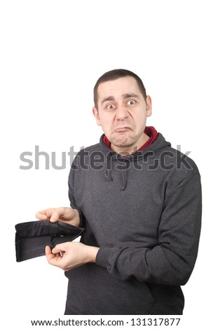 Man showing his empty wallet - stock photo