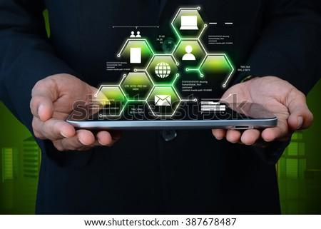 Man showing networking on mobile phone in color background  - stock photo
