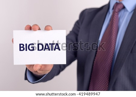 Man showing paper with BIG DATA text - stock photo