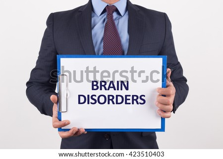 Man showing paper with BRAIN DISORDERS text - stock photo