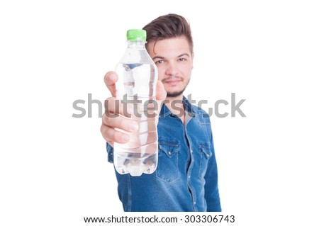Man showing plastic bottle with cold water to the camera isolated on white studio background - stock photo