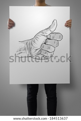 man showing poster hand drawn of hand giving a thumbs up as concept  - stock photo