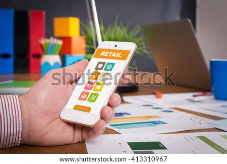 Man showing smartphone Retail on screen - stock photo