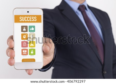 Man showing smartphone Success on screen - stock photo