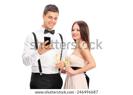 Man showing something on his cell phone to a woman isolated on white background - stock photo