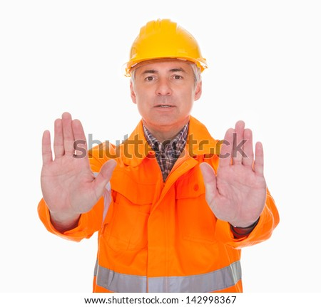 Man Showing Stop Sign Over White Background - stock photo
