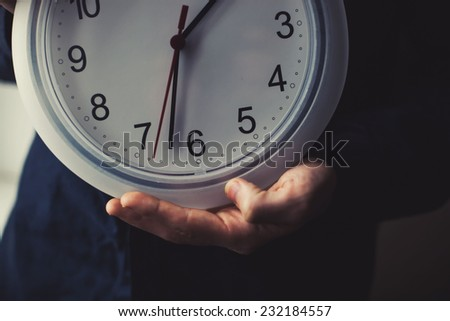 Man showing time on clock - stock photo
