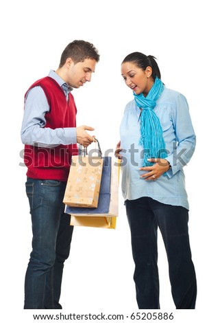 Man showing to his pregnant wife  inside of shopping bags and the woman being surprised and happy  isolated on white background - stock photo