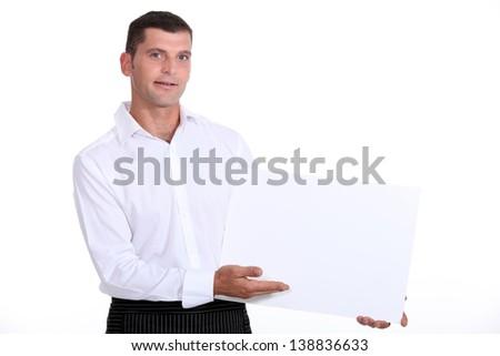 Man showing white panel - stock photo