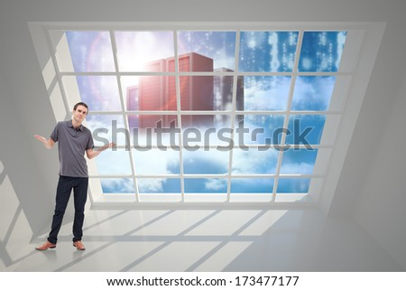 Man shrugging his shoulders against server tower seen through window - stock photo