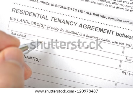 Man signing a rental contract - stock photo