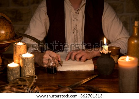 man signs a document, medieval theme - stock photo