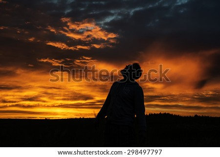 Man Silhouette on Sunset Background - stock photo