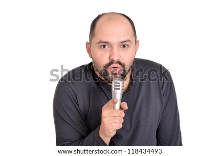 man singing into a microphone on a white background - stock photo