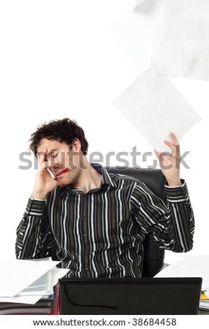 Man sitting at desk throwing up paperwork - stock photo