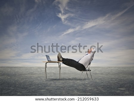 man sitting at his desk - stock photo