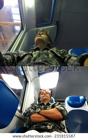 man sitting in a train, commuting concept - stock photo