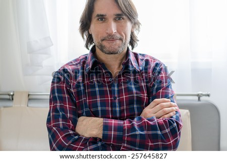 Man sitting in sofa at a home - stock photo